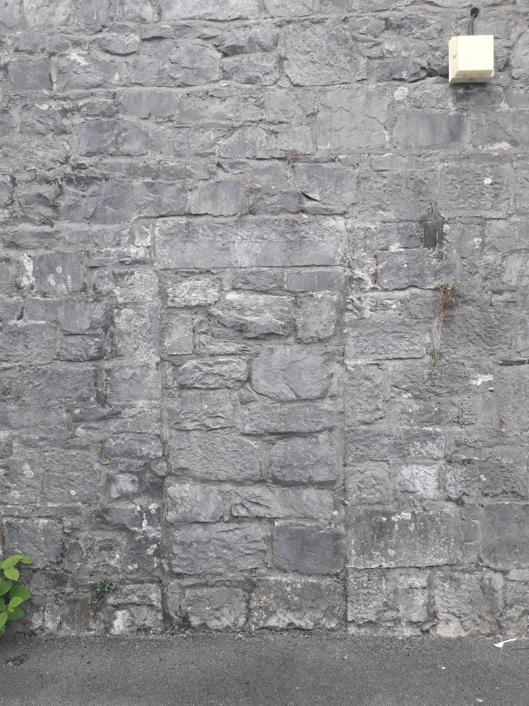 The now blocked-up doorway that is visible in the image of the IRA volunteer (Damian Shiels)